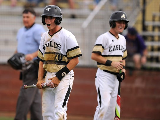 Abilene High's Wes Berry (20) and Andrew Ezzell (9)