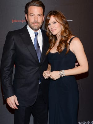 In this Nov. 19, 2014 file photo, Ben Affleck and Jennifer Garner attend the 2nd annual Save the Children Illumination Gala in New York. The couple have decided to divorce after 10 years of marriage, they announced in a joint statement Tuesday.