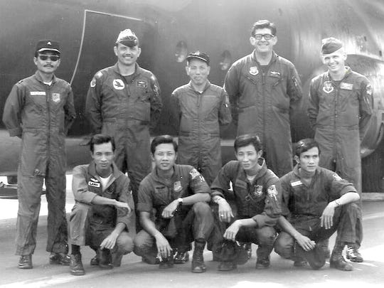 A U.S. Air Force C-130A pilot, flight engineer and loadmaster Master Sgt. Carl Sellers, far right, pose with the Vietnamese crew they are training at Tan Son Nhut Air Base in South Vietnam.