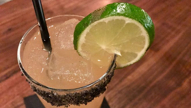 The Ancho Paloma made with blanco tequila, ruby-red grapefruit juice, ancho-infused liqueur, lime, and black-lava sea salt. It's one of 10 craft libations at Point 57 in Cape Coral.