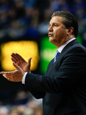 UK head coach John Calipari applauds his team against Ole Miss during their game at Rupp Arena.
