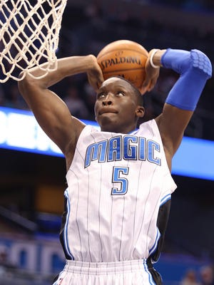 The Orlando Magic's Victor Oladipo goes up for a score against the Memphis Grizzlies at the Amway Center in Orlando, Fla., on Friday, Jan. 16, 2015. (Stephen M. Dowell/Orlando Sentinel/TNS)
