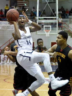 Callaway's Malik Newman drives through the Provine defense including Jerekius Davis (4) to score and complete a three-point play after being fouled and sinking the free throw on Friday night, February 6, 2015, at Forest Hill High School in Jackson.