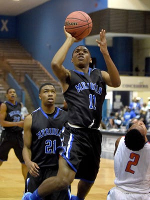Meridian's Brandon Miller (11) hits a short jumper in the lane against Southaven on Saturday, March 7, 2015, in the MHSAA state basketball tournament at the Lee E. Williams Athletics & Assembly Center on the Jackson State University campus in Jackson, Miss.