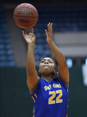 Bay High's Jamaya Galloway (22) shoots a three against Quitman on Wednesday, March 11, 2015, in the MHSAA State Basketball Tournament semifinals at the Mississippi Coliseum on the Mississippi State Fairgrounds in Jackson, Miss.