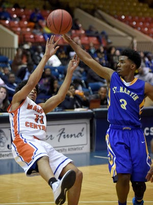 Shunn Buchanan (left) shoots an off-balance shot against St. Martin's Raheem Pleasant on Friday, March 6, 2015, in the MHSAA state basketball tournament at the Lee E. Williams Athletics & Assembly Center on the Jackson State University campus in Jackson, Miss.
