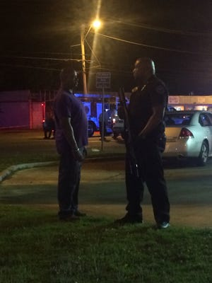 Officers maintain the perimeter at the Express Fuel Food Mart at Bailey Avenue and Northside Drive after a JPD officer was shot. His injuries were non-life threatening.