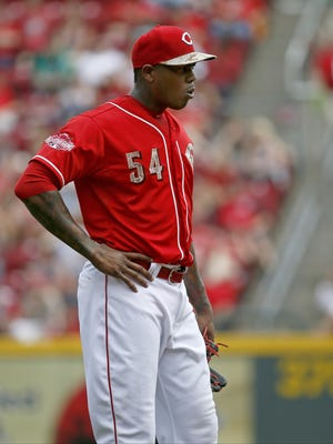 Reds closer Aroldis Chapman stands with his hand on his hip after a called ball during the top of the ninth inning.