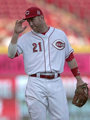 Reds third baseman Todd Frazier tips his hat to a fan prior to the start of the second inning in Monday's game.