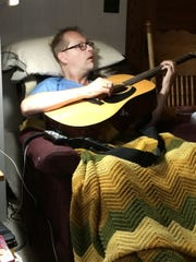 Tommy Womack is pictured two days after the wreck that shattered four bones in his pelvis. It was first time he'd played the guitar since the accident. The force of the impact from the crash dislodged the sound hole pickup, but the guitar was perfectly in tune.