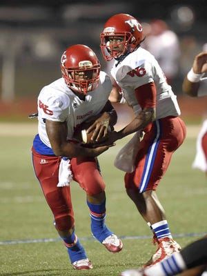 Warren Central quarterback Jesse Wilson (right) hands off to work horse running back Denarius Knight near the goal line on Friday, October 9, 2015, at Madison Central High School in Madison, Miss.