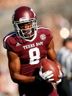 Former Texas A&M wide receiver Thomas Johnson is a suspect in the stabbing death of a Dallas jogger.