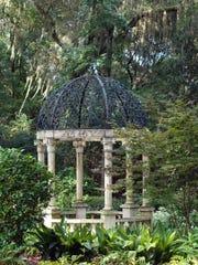 Wrought-iron gazebo with cupola.