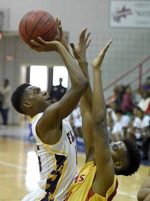 Columbus Falcon sophomore Robert Woodard, Jr. shoots over Provine's Eddie Galloway on Saturday, November 21, 2015, in the Orsmond Jordan Showcase basketball tournament at Forest Hill High School in Jackson, Miss.
