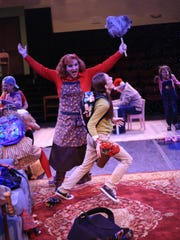"""The cast of St. George Musical Theater's production of """"The Christmas Bus"""" rehearses for the play Wednesday at the St. George Opera House."""