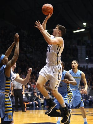 Butler's Kellen Dunham, the game's high scorer with 22 points, eyes the basket in the first half of the Bulldogs' 73-52 win over Marquette at Hinkle Fieldhouse in Indianapolis on Wednesday, Feb. 25, 2015.
