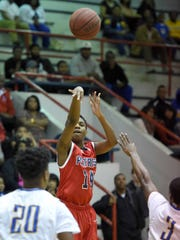 Forest Hill's Kenna Bryant (14) hits his third three pointer against Velma Jackson in the first half at the JPS Holiday Tournament on Monday, December 28, 2015, at Forest Hill High School in Jackson, Miss.