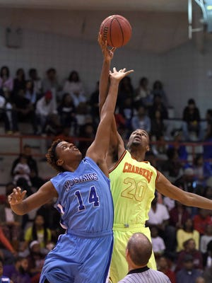 Callaway's Damion Moore (20) wins the opening tip against Murrah's Adam Wallace (14) in the championship game of the JPS Holiday Tournament on Tuesday, December 29, 2015, at Forest Hill High School in Jackson, Miss.