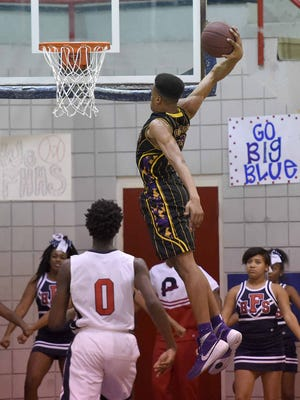 The  Falcons' Robert Woodard II prepares to throw down a dunk against Forest Hill Friday night at Forest Hill High School in Jackson.