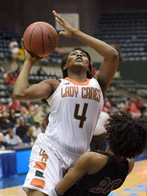 West Harrison's Ameshya Williams goes up for a shot against Hattiesburg in the Class 5A semifinals on Tuesday at Mississippi Coliseum. Williams had 22 points, 20 rebounds and four blocked shots in a 53-39 win.