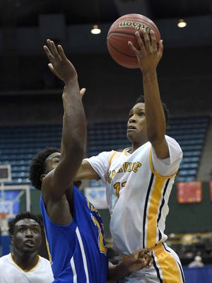 Starkville's Tyson Carter (right) shoots over Tupelo's Tre Jenkins on Wednesday in a Class 6A semifinal at Mississippi Coliseum.