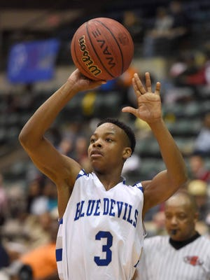 Ashland's DeAnthony Tipler scans the court for an open teammate in the 1A Quarterfinals against West Lowndes.