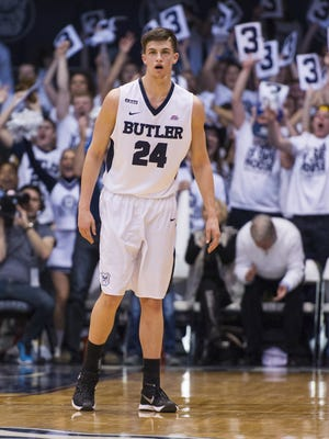 Butler Bulldogs guard Kellen Dunham (24) after hitting a three-point basket during the first half of a NCAA men's basketball game at Butler University's Hinkle Fieldhouse, Saturday, Feb. 13, 2016.