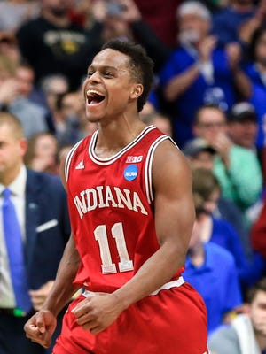 Indiana's Kevin Yogi Ferrell (11) celebrates the team's 73-67 win over Kentucky in the second round of the men's college basketball game in the NCAA tournament in Des Moines, Iowa, Saturday, March 19, 2016.