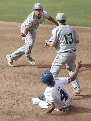 Montwood short stop Fernie Zubia flips the ball to second baseman Miguel Soto as Americas' Adrian Gomez slides into second in the Fred Loya High School Baseball Series on Tuesday at Southwest University Park.