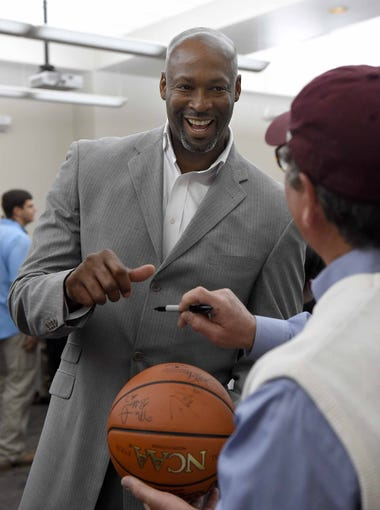 Erick Dampier signs a basketball for a Mississippi State fan at a reception on Thursday, March 31, 2016, at the Mississippi Sports Hall of Fame and Museum in Jackson, Miss. The MSHOF museum hosted an event. Farm Bureau Salutes the Final Four Bulldogs, honoring Mississippis only Final Four men's basketball team from the 1996 NCAA tournament.