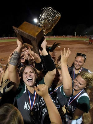 Mooreville pitcher Hallie Donald hoists the Class 3A trophy as the Lady Troopers celebrate the championship with a 9-6 win over Philadelphia on Friday night at Freedom Ridge Park in Ridgeland.