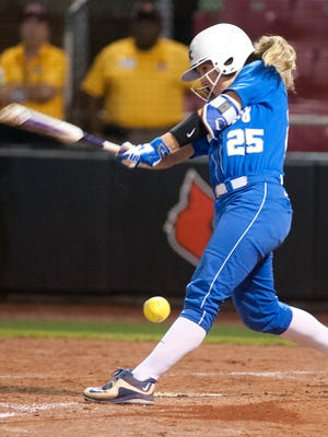 UK's Brooklin Hinz singles, driving in UK's Nikki Sagermann for the go-ahead run in the top of the 9th inning against Louisville. 27 April, 2016