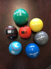 Plyo-balls and weighted baseballs used by clients of