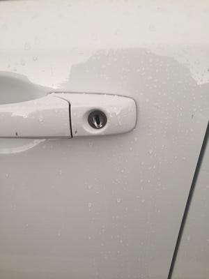 The door lock that was damaged when a vacationing Indiana family's car was broken into and about $10,000 worth of personal items taken.