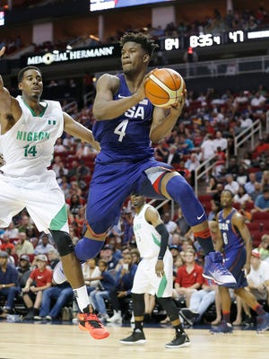 United States guard Jimmy Butler drives against Nigeria center Alade Amiu in the second quarter during an exhibition basketball game.