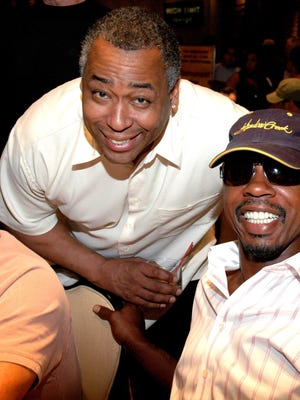 """John Saunders, left, and Greg Anthony play poker in Celebrity Basketball's """"Old School vs. New School"""" Poker Tournament in Las Vegas in 2006. Saunders died at age 61."""