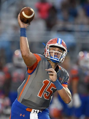 Madison Central quarterback Jack Walker throws a sideline route against Germantown at the 2016 Madison County Football Jamboree on Friday, August 12, 2016, at Germantown High School in Gluckstadt, Miss.