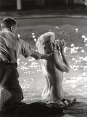 """Marilyn Monroe, seen here between scenes on the set of """"Something's Got to Give,"""" in which she wears a flesh-toned bikini."""