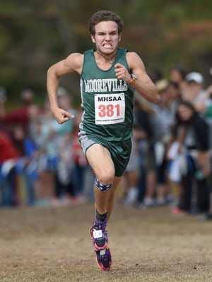 Mooreville's Dylan Allen wins the Class 3A boys race on Saturday.