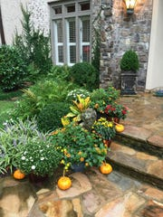 Marie Butler of southeastern Virginia favors fall containers