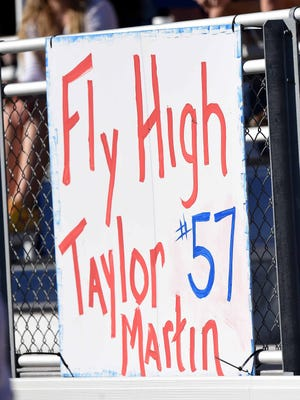 Signs honoring Taylor Martin were prominent throughout the stadium in the MAIS Academy A-AA championship on Thursday at Jackson Academy.