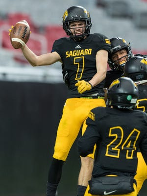 Saguaro's Jacob Christofferson (7) celebrates his second quarter touchdown with his teammates during the Division 4A State Championship game on Saturday, Nov. 26, 2016, at University of Phoenix Stadium in Glendale.