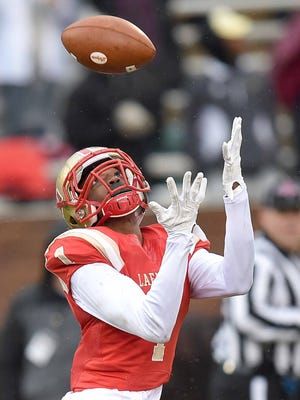 Lafayette's Tyler Carmichael-Williams (1) catches a long touchdown pass for the Commodores on Saturday, December 3, 2016, at the MHSAA Football State Championships in Davis Wade Stadium on the Mississippi State University campus in Starkville, Miss.