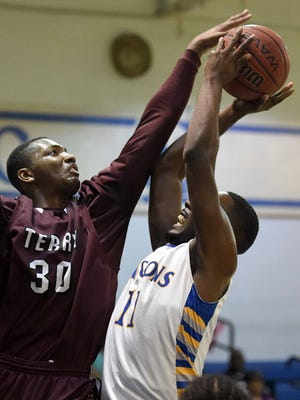 Terry's Jimmy Burse (30) tries to block the shot by Wingfield's Robert Washington (11) on Monday in the JPS Pepsi Holiday Tournament at Murrah.