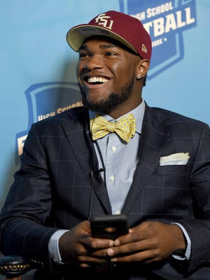 "Cam Akers comments on how his phone was ""blowing up"" in the few minutes it took him to walk 20-feet to the interview area following his college choice announcement on Tuesday, December 27, 2016, at the Mississippi Sports Hall of Fame and Museum in Jackson, Miss."