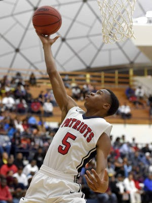 Forest Hill's Keondre Montgomery scores from under the basket against Olive Branch on Monday.