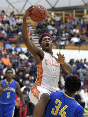 Callaway's Tanarrio Ransburgh (0) shoots off the drive over Velma Jackson's Antwain Dixon (34) on Monday, January 16, 2017, in the Rumble in the South high school basketball tournament at the A.E. Wood Coliseum on the Mississippi College campus in Clinton, Miss.