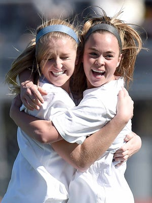 Madison Central's Maggie Overby (right) celebrates her first of her two first-half goals with teammate Kate Russell Snopek on Saturday against Tupelo.