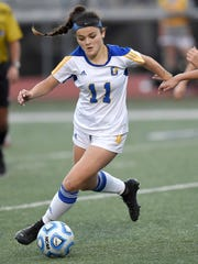 Oxford's Morgan O'Connor (11) dribbles through the West Harrison defense on Saturday, February, 4, 2017, at the MHSAA Soccer Classic, Class 4A and 5A state championships, at Madison Central High School in Madison, Miss.