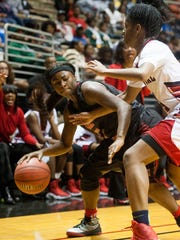 Lee's Ti'erra Lee  drives against Central-Phenix City's Tiyah Johnson at the AHSAA Regional Basketball Championships on the Alabama State University campus in Montgomery, Ala. on Thursday February 16, 2017.